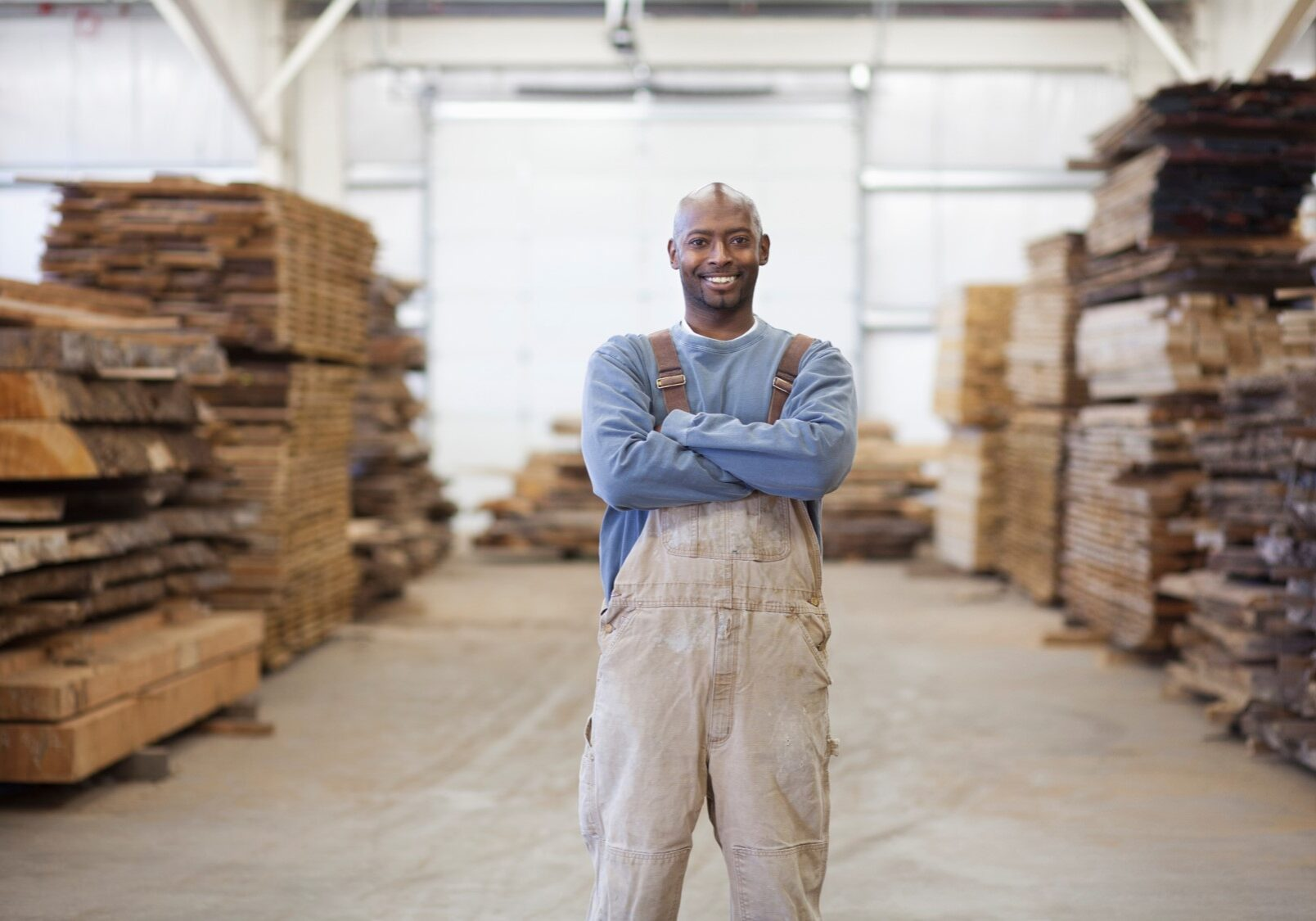 black man surrounded by wood pallets