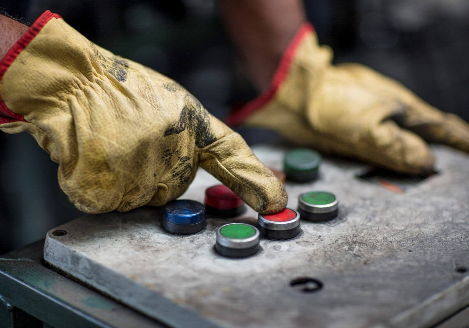 worker pushing buttons